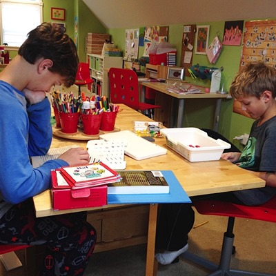 boys at the table homeschooling
