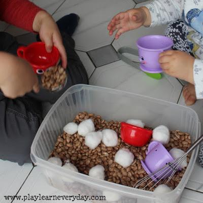 hot-chocolate-sensory-bin-scooping