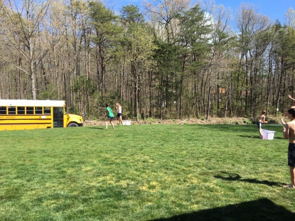 water ballon with school bus driving by